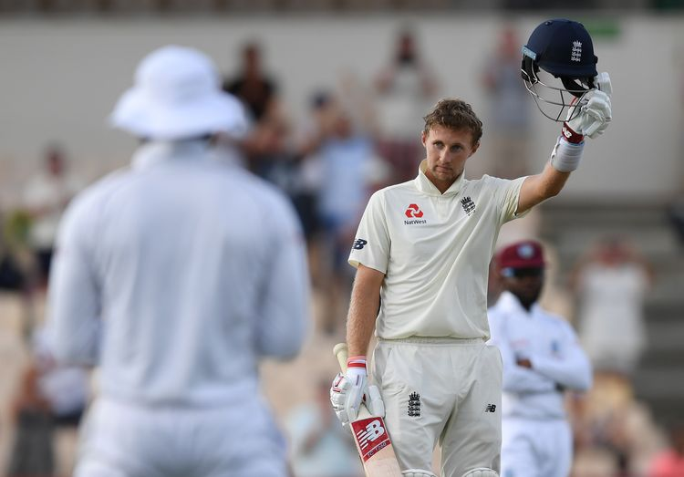 England captain Joe Root celebrates reaching his 100 during Day Three of the Third Test match between the West Indies and England